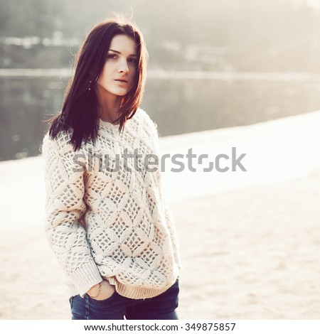 Outdoor fashion closeup portrait of beautiful woman posing in winter sunny cold weather  - stock photo