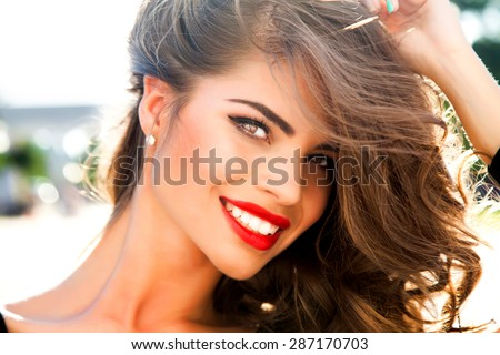 Outdoor fashion portrait of glamour lady with perfect make-up and glowing skin,full red lips,and big eyes posing at sunset,tan model face.Sexy perfect fit body woman.Attractive sexy and young girl - stock photo