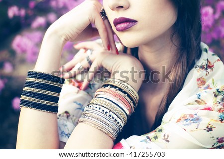 Outdoor fashion portrait of young beautiful woman. Boho chic style, hippie chic vibe outfit, details  - stock photo