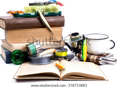 outdoor fishing tackles and baits with books on white background  - stock photo