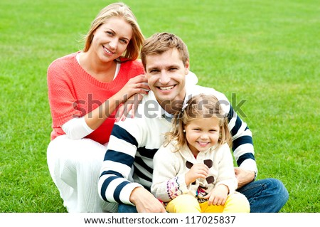 Outdoor happy caucasian family relaxing. Bright sunny day - stock photo