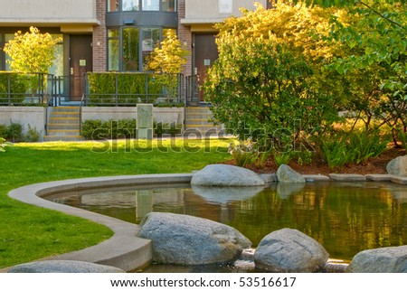 Outdoor landscape garden with pond in North Vancouver, British Columbia, Canada. Sunset light. - stock photo
