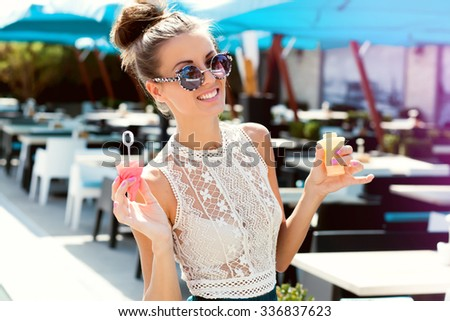 Outdoor lifestyle,colored portrait of sensual sexy hipster girl going,fancy woman going crazy,bright clothes and accessories,stylish color sunglasses,joy,party. Sportive urban street style look - stock photo