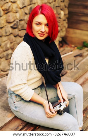 Outdoor lifestyle portrait of pretty young hipster woman making photo. Retro photographer. Modern urban girl has fun with vintage photo camera.  - stock photo