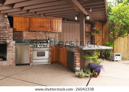 Outdoor modern kitchen that has been freshly remodeled - stock photo