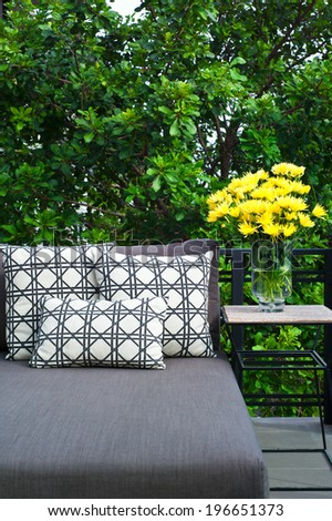 Outdoor patio seating with nice grey daybed - stock photo
