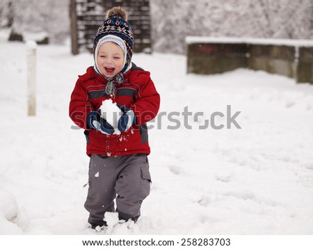 outdoor portrait baby during winter - stock photo