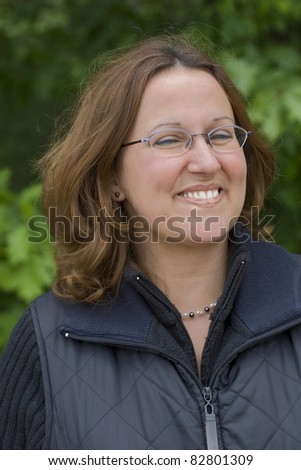 Outdoor portrait happy woman - stock photo