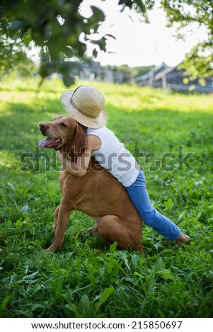 Outdoor portrait: Little boy and Hungarian Vizsla   - stock photo