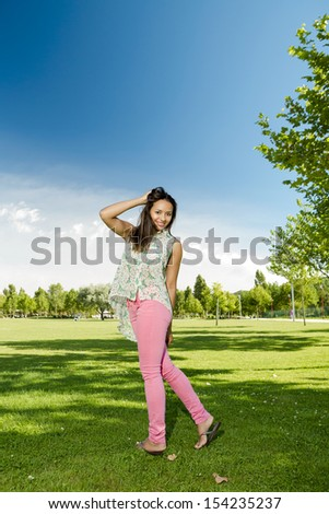 Outdoor portrait of a beautiful African American woman in the park - stock photo