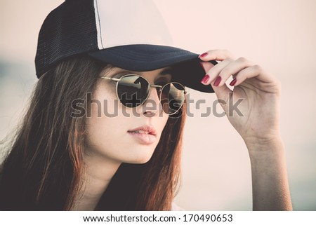 Outdoor portrait of a  beautiful and fashion young woman - stock photo
