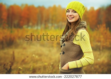 outdoor portrait of a beautiful brunette middle aged woman - stock photo