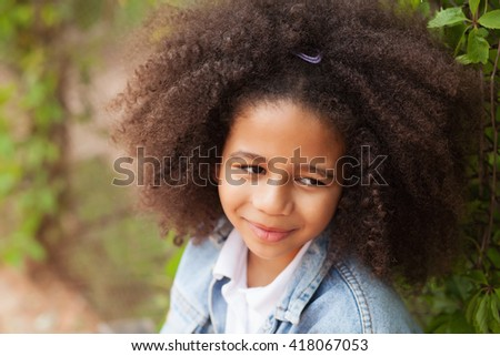 Outdoor portrait of a beautiful little girl  - stock photo