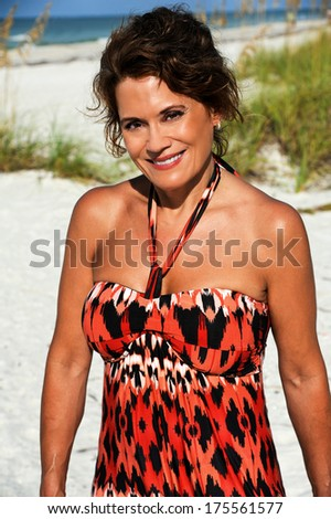 Outdoor Portrait of a Beautiful Mature Woman on the Beach - stock photo