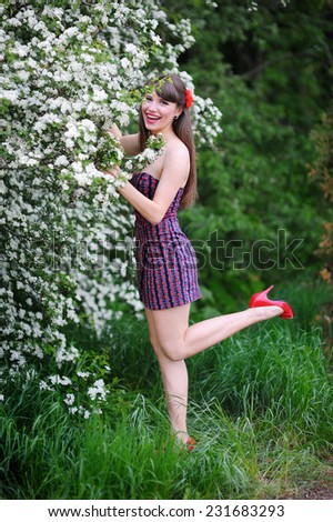 Outdoor portrait of a beautiful woman in spring. - stock photo