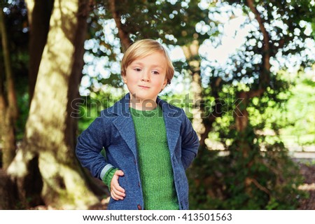 Outdoor portrait of a cute little boy of 4 years old - stock photo