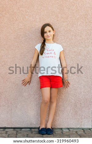 Outdoor portrait of a cute little girl of 9 years old  - stock photo