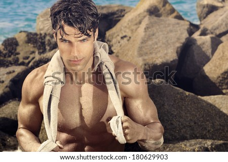 Outdoor portrait of a fit sexy fit man - stock photo