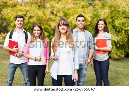 Outdoor portrait of a group of smiling students - stock photo