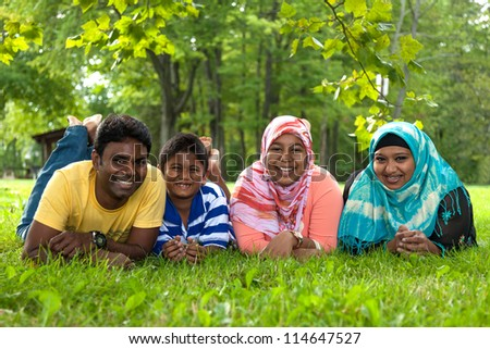 Outdoor Portrait of a indian family - stock photo