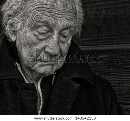 Outdoor Portrait of a senior man with Sadness - stock photo