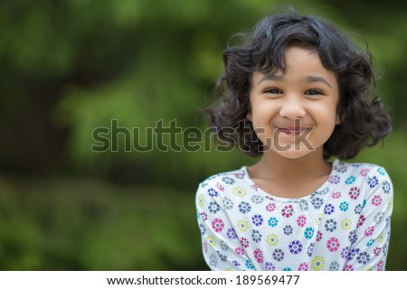 Outdoor Portrait of a Smiling Little Girl - stock photo