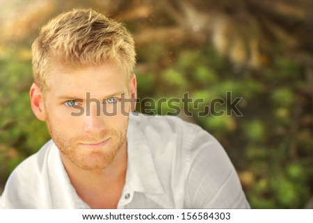 Outdoor portrait of a young man - stock photo