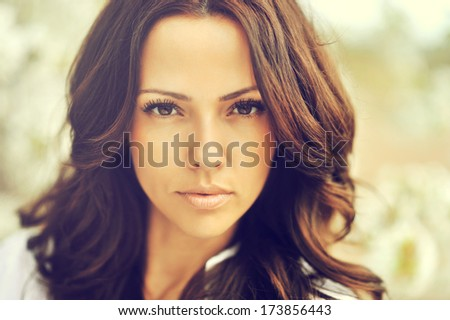 Outdoor portrait of amazing brown hair beautiful woman  - stock photo