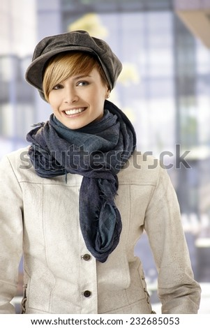 Outdoor portrait of attractive young woman in winter - stock photo