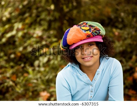 outdoor portrait of biracial girl shot in the fall - stock photo