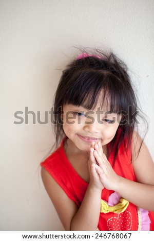 outdoor portrait of cheeky little girls.pay respect - stock photo