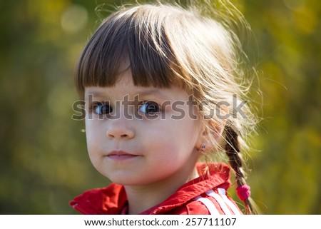 outdoor portrait of cute girl - stock photo