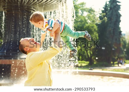outdoor portrait of father and son. child and dad walk in the summer park - stock photo