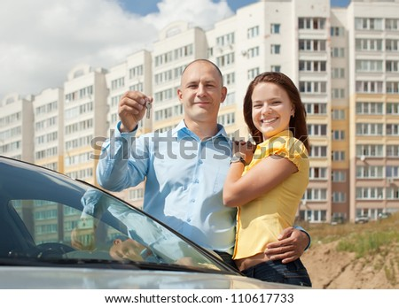 Outdoor portrait of   happy couple against real estate - stock photo