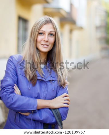 Outdoor portrait of long-haired woman - stock photo