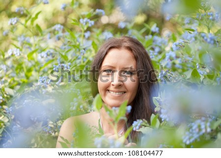 Outdoor portrait of middle age brunette woman - stock photo