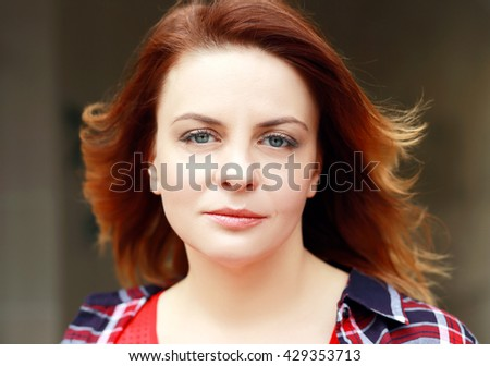 Outdoor portrait of middle age red haired woman - stock photo