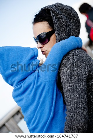Outdoor portrait of mother holding her daughter - stock photo