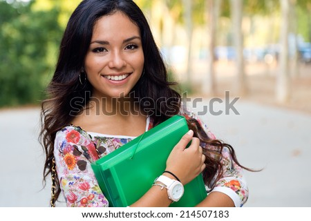 Outdoor portrait of pretty student girl in the street. - stock photo
