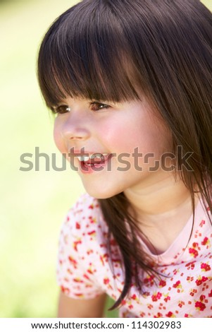 Outdoor Portrait Of Smiling Young Girl - stock photo