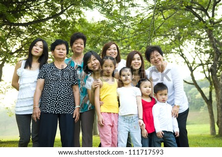 outdoor portrait of three generations family - stock photo