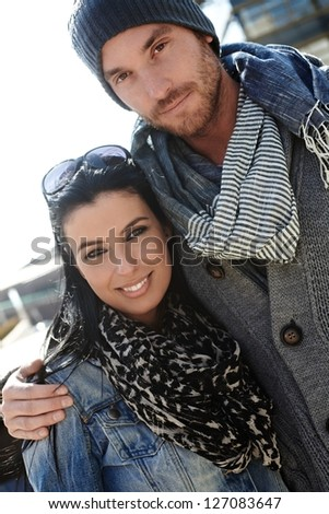 Outdoor portrait of trendy young couple wearing scarf. - stock photo