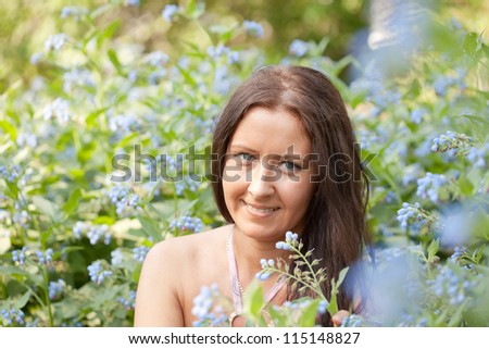 Outdoor portrait of  woman in spring  garden - stock photo