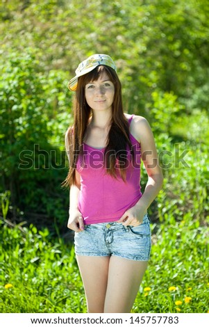 Outdoor portrait of young brunette woman - stock photo
