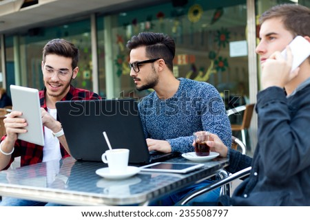 Outdoor portrait of young entrepreneurs working at coffee bar. - stock photo