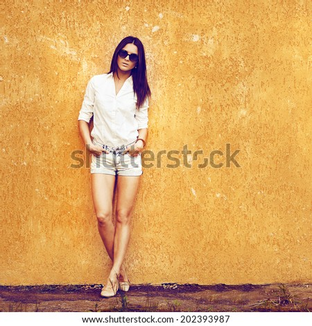 Outdoor portrait of young fashion woman wearing sunglasses - full length  - stock photo