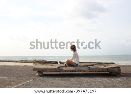 Outdoor portrait of young writer/blogger/freelancer/student with laptop - stock photo