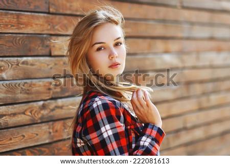Outdoor portrait sensual pretty woman in the city - stock photo