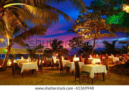 Outdoor restaurant at the beach during sunset, Phuket, Thailand - stock photo