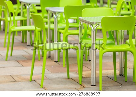 Outdoor restaurant coffee open air cafe green chairs with table. Summer vacation on resort - stock photo